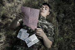 Soldier with letter. Received from his girlfriend Royalty Free Stock Images