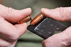 Soldier load ammo in clip Colt. Soldier load ammo in the clip Colt Royalty Free Stock Photography