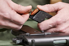 Soldier load ammo in clip Colt. Soldier load ammo in the clip Colt Stock Image