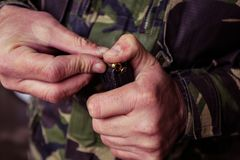 Soldier loading a 9mm caliber cartridge. On a military shooting range Royalty Free Stock Photography
