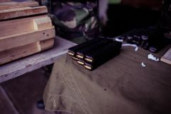 Soldier loading a 9mm caliber cartridge. On a military shooting range Stock Photography