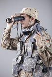 Soldier looking through binoculars Royalty Free Stock Photos