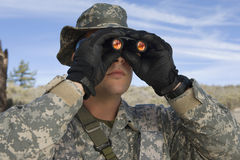 Soldier Looking Through Binoculars Stock Photo