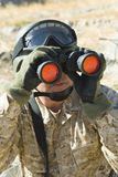 Soldier Looking Through Binoculars While Patrolling Royalty Free Stock Photos