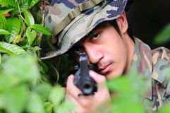 Soldier looking through the iron sights Royalty Free Stock Photography