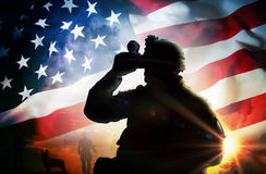 Soldier looks through binoculars. At sunset Royalty Free Stock Photo