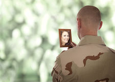 Soldier looks at the picture Royalty Free Stock Images