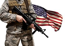 American flag and soldier. Soldier with m4 weapon against american flag waving in the wind on white background stock footage