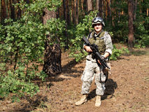 Soldier with M4 Carbine. Soldier in ACU holding the Colt M4 carbine with M203 grenade launcer royalty free stock photos