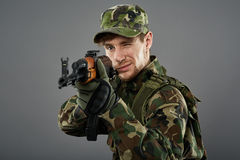 Soldier with machine gun aiming Stock Image