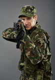 Soldier with machine gun aiming Stock Photo