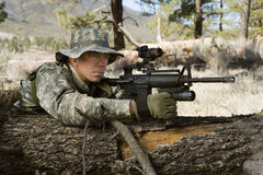 Soldier With Machine Gun Leaning On Log Stock Images
