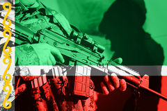 Soldier with machine gun with national flag of Chechnya Royalty Free Stock Photography
