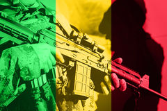 Soldier with machine gun with national flag of Mali. Flag Royalty Free Stock Image