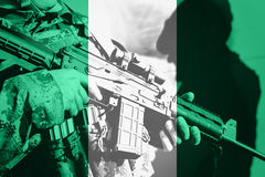 Soldier with machine gun with national flag of Nigeria. Flag royalty free stock photo