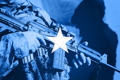 Soldier with machine gun with national flag of Somalia. Flag Stock Images