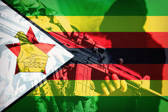 Soldier with machine gun with national flag of Zimbabwe Royalty Free Stock Image