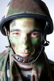 Soldier make up. Soldier portrait with helmet and make up Royalty Free Stock Photo