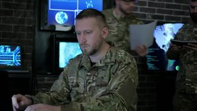 Soldier male portrait, technical control, tracking system, IT war, stock footage