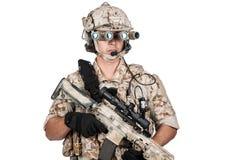 Soldier man full armor hold machine gun  Royalty Free Stock Image