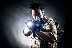 Soldier man hold gun fashion Stock Photography