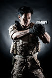 Soldier man hold gun fashion Stock Image