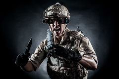 Soldier man hold knife fashion Royalty Free Stock Image