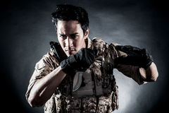 Soldier man hold knife fashion Stock Image