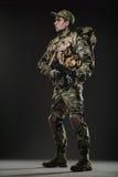 Soldier man hold Machine gun on a  dark background Stock Images