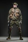 Soldier man hold Machine gun on a  dark background Stock Image