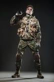 Soldier man hold Machine gun on a  dark background Royalty Free Stock Images