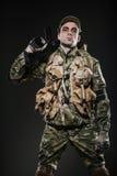 Soldier man hold Machine gun on a  dark background Stock Photos