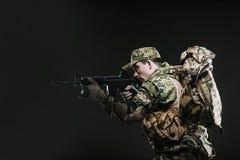 Soldier man hold Machine gun on a  dark background Royalty Free Stock Photo