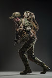 Soldier man hold Machine gun on a  dark background Royalty Free Stock Photos