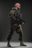 Soldier man hold Machine gun on a dark background. Military, war, conflict, soldiers - Special forces soldier man hold Machine gun on a dark background. Military royalty free stock images