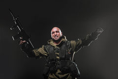 Soldier man hold Machine gun on a  dark background Royalty Free Stock Image