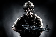 Soldier man hold Machine gun style fashion Stock Photography