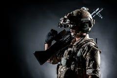 Soldier man hold Machine gun style fashion Stock Photos