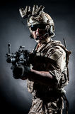 Soldier man hold Machine gun style fashion Royalty Free Stock Photo