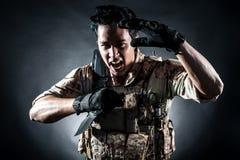 Soldier man hold Machine gun style fashion. Soldier man hold Machine gun fashion stock image