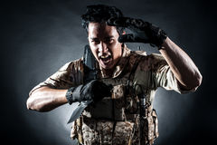 Soldier man hold Machine gun style fashion stock image