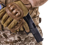 Soldier man holding his gun Stock Images