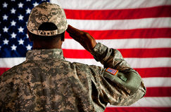 Soldier: Man Saluting Flag. Series with an anonymous African-American soldier on a United States Flag background royalty free stock photo
