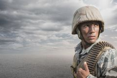 Soldier man standing against desert background Stock Photo