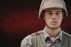 Soldier man standing against red background Stock Photos