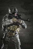 Soldier with mask aiming a rifle Stock Image