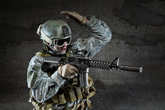 Soldier with mask aiming a rifle Stock Photo