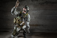 Soldier with mask looking up Stock Photography