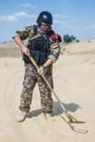 Soldier with metal detector Royalty Free Stock Photos
