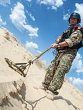 Soldier with metal detector Royalty Free Stock Image